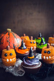 Scary Halloween cup cakes. On the table with blank space,selective focus Royalty Free Stock Photos