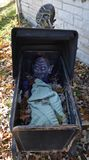 Scary Halloween decoration on a fall day. Creepy outdoor Halloween display on sunny,autumn day Royalty Free Stock Photos