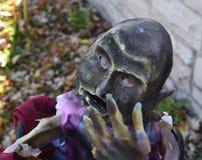 Scary Halloween decoration on a fall day. Creepy outdoor Halloween display on sunny,autumn day Stock Photo