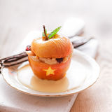 Scary Halloween dessert - baked stuffed apple Royalty Free Stock Images