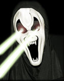 Scary Halloween Figure. Halloween Character with Beams of Light Coming from Eyes Royalty Free Stock Image