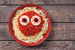 Scary halloween food pasta with big red eyes Royalty Free Stock Photography