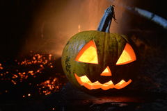 Scary halloween jack head on dark backround. With fire Royalty Free Stock Image