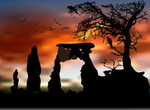 Scary halloween landscape with silhouettes of tree, birds and stone gate Royalty Free Stock Image