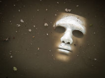 Scary Halloween mask drown in the water Stock Photo