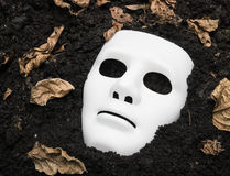 Scary Halloween mask on the ground Stock Image