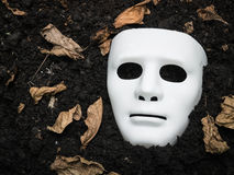 Scary Halloween mask on the ground Stock Photo