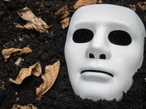 Scary Halloween mask on the ground Royalty Free Stock Photos