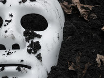 Scary Halloween mask on the ground Royalty Free Stock Photography