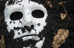 Scary Halloween mask on the ground Royalty Free Stock Image