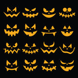 Scary Halloween orange pumpkin faces icons set on black Stock Photography