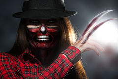 Scary halloween portrait of woman with knifes in hand Stock Photo