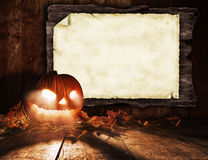 Scary halloween pumpkin with blank board Stock Photos