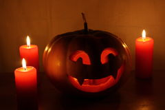 Scary Halloween pumpkin with candles on a dark Royalty Free Stock Photos