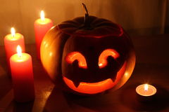 Scary Halloween pumpkin with candles on a dark Royalty Free Stock Image