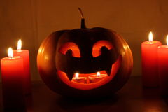 Scary Halloween pumpkin with candles on a dark Stock Photography