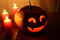 Scary Halloween pumpkin with candles on a dark Stock Photo