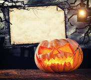 Scary halloween pumpkin with empty sign board Royalty Free Stock Image