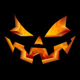 Scary Halloween Pumpkin Face, Carved Jack O Lantern Laughing and Smiling Fire Flames Lighting Interior Stock Photos