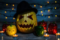 Scary halloween pumpkin in hat with scar on face and colorful pe stock image