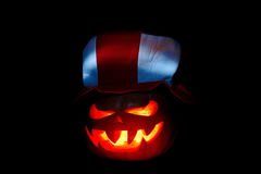 Scary Halloween pumpkin isolated on a black background glow from Royalty Free Stock Images