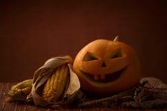 Scary halloween pumpkin jack-o-lantern. On dark background Royalty Free Stock Images