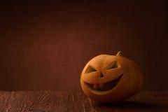 Scary halloween pumpkin jack-o-lantern. On dark background Stock Image