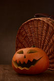 Scary halloween pumpkin jack-o-lantern. On dark background Royalty Free Stock Photos