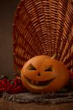 Scary halloween pumpkin jack-o-lantern. On dark background stock photography