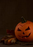 Scary halloween pumpkin jack-o-lantern. On dark background Royalty Free Stock Image