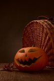 Scary halloween pumpkin jack-o-lantern. On dark background Stock Photography