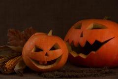 Scary halloween pumpkin jack-o-lantern. On dark background Royalty Free Stock Photography