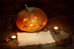 Scary Halloween pumpkin and old burned paper Royalty Free Stock Photography