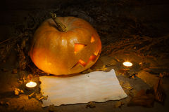 Scary Halloween pumpkin and old burned paper Stock Images