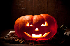 Scary Halloween pumpkin on a old wooden background Stock Photos