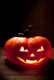 Scary Halloween pumpkin on a old wooden background Royalty Free Stock Photos