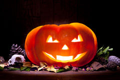Scary Halloween pumpkin on a old wooden background Stock Photo