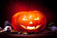 Scary Halloween pumpkin on a red wooden background Stock Photo