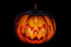 Scary Halloween pumpkin resembling a Chinese dragon head, isolat Royalty Free Stock Image