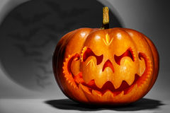 Scary Halloween pumpkin resembling a Chinese dragon head, with a Royalty Free Stock Images