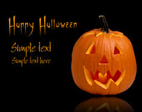 Scary Halloween pumpkins. Scary Halloween ghost pumpkins isolated on black stock photo