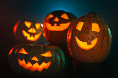 Scary Halloween Pumpkins glowing in the dark Stock Photos