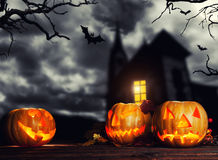 Scary halloween pumpkins with horror background royalty free stock image