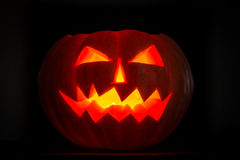 Scary halloween pumpkins jack-o-lantern candle lit Stock Photos
