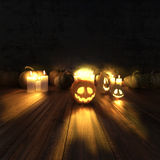 Scary halloween pumpkins and lit candles. Royalty Free Stock Photography