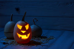 Scary halloween pumpkins in old barn. At night Stock Image