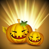 Scary Halloween pumpkins on shiny rays background. Royalty Free Stock Photos