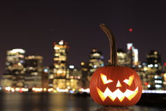 Scary Halloween's pumpkin. Scary pumpkin, symbol of Halloween, waiting for a celebrate on the shores of Brooklyn, against Manhattan Island, New York, United stock photography