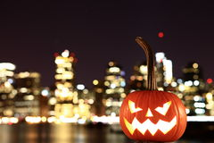 Scary Halloween's pumpkin. Scary pumpkin, symbol of Halloween, waiting for a celebrate on the shores of Brooklyn, against Manhattan Island, New York, United royalty free stock photography