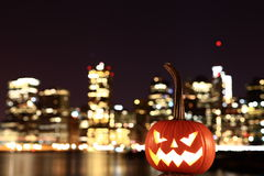 Scary Halloween's pumpkin. Scary pumpkin, symbol of Halloween, waiting for a celebrate on the shores of Brooklyn, against Manhattan Island, New York, United stock photos